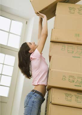 Woman with recycled boxes piled high