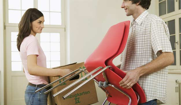 Young couple preparing their home for movers to pick up furniture